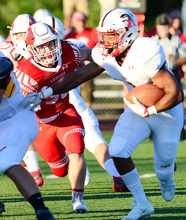 Neshannock's Sean Doran moves in on the quarterback.