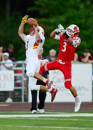 Neshannock's Joey Nerti succeeds in breaking up a pass intended for the defense.