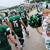 Laurel midget and pewee football players and cheerleaders make a gaunlet for the team to enter the field Friday evening for a game against Riverside.