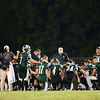 Laurel's team gathers on the field after a loss to Riverside.