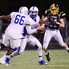 Wilmington's Ryan Byler makes his way to Sharpsville's quarterback.