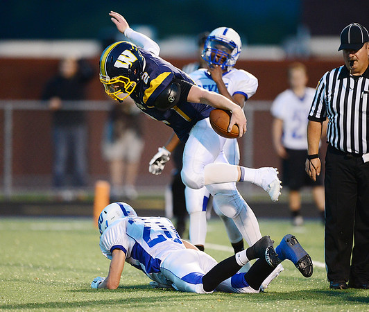 Wilmington's Spencer DeMedal jumps over a Sharpsville defender to score for the hounds.