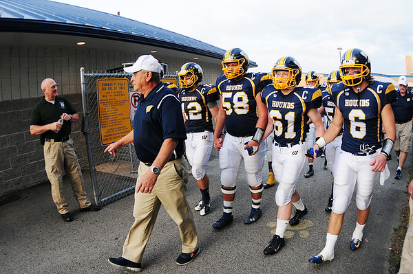 Wilmington Greyhounds coach Terry Verrelli leads his team to the field in his 38th year of coaching.