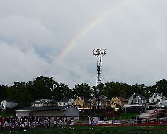 A double rainbow appears before the start of Friday's game.