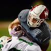 Neshannock's Ty Sear takes on a Riverside defender.