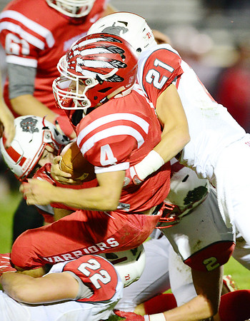 Mohawk's Damien Nowicki gets taken down while carrying the ball.