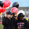 Sophomore student council members brave the cold and the rain to hold balloons for senior night at New Castle's Taggart Stadium. From left Braden Stillwagon, Thomas MacIntyre and Janaya Lane.