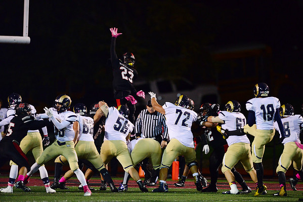 New Castle's Marcus Hooker attempts to block the extra point.