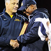 Shenango's Athletic Director Jan Budai presents an award to coach Harold Taylor for his 31 years of service.