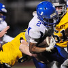 A Shenango defender brings down Union's Tre'von Charles.