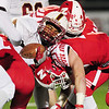 A serra catholic ball carrier meets the Neshannock defense.