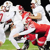 Neshannock's Mason Davidson takes down a Serra Catholic ball carrier.