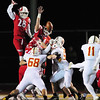 Neshannock's Danny Welker top and Mason Davidson bottom jump to block an extra point.