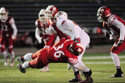 Neshannock's Sean Doran grabs North Catholic's quarterback.