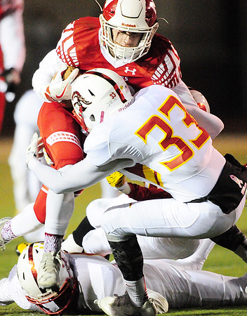 Neshannock's Danny Welker climbs over North Catholic defenders.