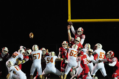 Neshannock's Danny Welker top and Mason Davidson jump to block a North Catholic extra point.