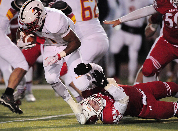 Neshannock's Sean Doran brings down a North Catholic ball carrier.