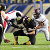 Defenders Devin Sams left and Jaylon Lane take down a Thomas Jefferson ball carrier.