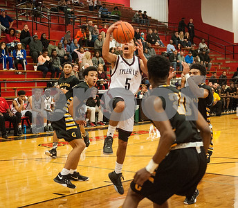 Robert E. Lee's (5) Isaiah Davison goes for a basket in the third quarter of their game at home against Garland High School Tuesday Jan. 5, 2015.  (Sarah A. Miller/Tyler Morning Telegraph)
