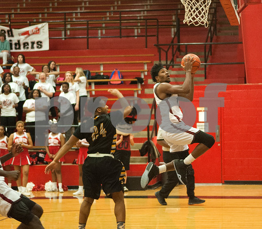 Robert E. Lee's (11) Isjuwan Barker makes a basket in the second half of their game at home against Garland High School Tuesday Jan. 5, 2015.  (Sarah A. Miller/Tyler Morning Telegraph)