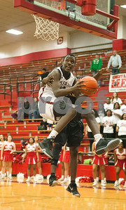 Garland's (4) Ty Green can't stop Robert E. Lee's (33) Dephen Walker from making a basket in the fourth quarter of their game at home Tuesday Jan. 5, 2015.  (Sarah A. Miller/Tyler Morning Telegraph)