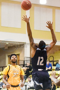 Tyler Junior College's Jason Bush (22) watches his passed ball as Coastal Bend's Cory Holt (12) jumps to try to block it during a college basketball game at Tyler Junior College in Tyler, Texas, on Monday, Jan. 7, 2019. (Chelsea Purgahn/Tyler Morning Telegraph)