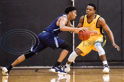 Coast Bend College's Royce Hunter (4) dribbles the ball as Tyler Junior College's Jonathan Bryant's (5) guards him during a college basketball game at Tyler Junior College in Tyler, Texas, on Monday, Jan. 7, 2019. (Chelsea Purgahn/Tyler Morning Telegraph)