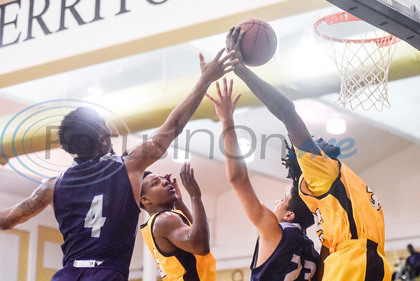 Coast Bend College's Royce Hunter (4) reaches to try to block Tyler Junior College's Rory Pantophlet's (34) shot during a college basketball game at Tyler Junior College in Tyler, Texas, on Monday, Jan. 7, 2019. (Chelsea Purgahn/Tyler Morning Telegraph)