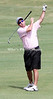 Keith Brockman loses his club as he tries to drive to the green