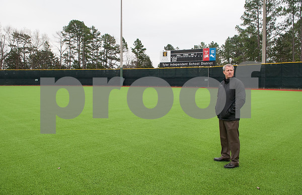 Tyler ISD athletic director Greg Priest stands in the outfield on the new turf at Mike Carter Field Wednesday Jan. 6, 2016. Mike Carter Field is the home baseball field Robert E. Lee and John Tyler High Schools as well as Tyler Junior College.   (Sarah A. Miller/Tyler Morning Telegraph)