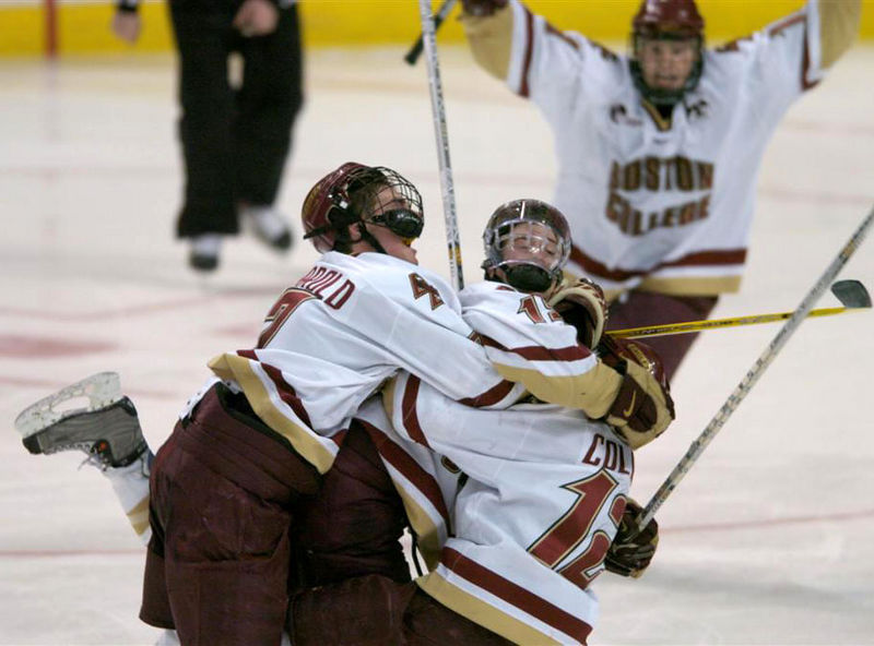 Ryan Murphy, center, is swarmed after scoring the winning goal in overtime in the 2004 Beanpot Finals at the Fleet Center in Boston, Monday, February 9, 2004.