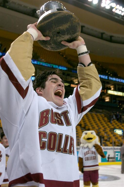 Brian Boyle holds up the Beanpot trophy