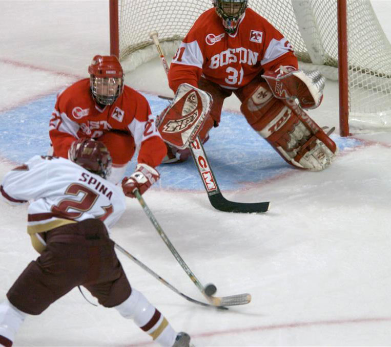Dave Spina has his shot blocked by BU's Thomas Morrow