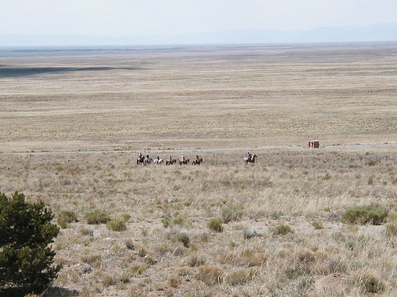 Day 6: a (horse) riding group going along the edge of the San Luis Valley between the San Juan Mountains and the Sangre de Cristo mountains (part of the Rockies).