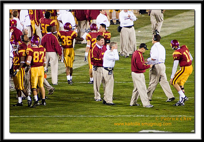 Pete Carroll and assistant coaches during a time-out.