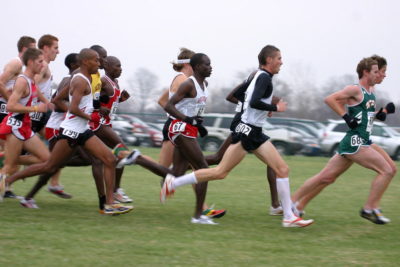 Lead pack at 5K: Simon Bairu #799. #67 Peter Kosgei,