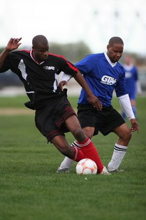 THE A-TEAM FC vs. B.M.A. - Darren Powlett(l), Marcus Heron(r)
