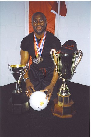 """THE HARDWARE"" - BAS FEATURED MEMBER, Barry Mowatt, coach of UNITED BLACK DEVILS poses with the ""fruits of his labours""."