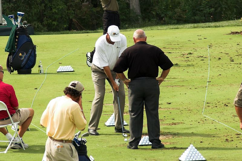 Butch Harmon providing some last minute tips to Stewart Cink