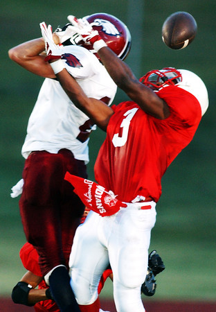 Globe/T. Rob Brown<br /> A Joplin High School pass intended for Logan Taylor (2) is broken up by Seneca High School's Ishmael Hankins (3) during the Football Jamboree 2006 at Missouri Southern State University's Fred G. Hughes Stadium.<br /> Section: Sports