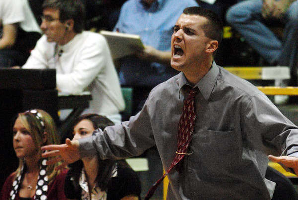 Globe/T. Rob Brown<br /> Carl Junction Bulldog head coach barks out orders to the players as the pressure builds in the last few seconds of regulation play in the face off against Francis Howell Central Wednesday afternoon during the Neosho Holiday Classic, Dec. 27, 2006, at Neosho High School.<br /> Section: Sports