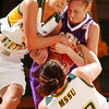 Globe/T. Rob Brown<br /> MSSU's Meghan Welch (12) and Liz Burks (3) fight for control of a loose ball with a Southwest Baptist player during Wednesday night's game, Feb. 1, 2006, at MSSU's Leggett & Platte Athletic Center.<br /> Section: Sports