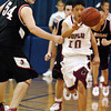 Globe/T. Rob Brown<br /> Joplin's (10 - not on roster) passes to a teammate around McDonald County defender Chris Price during Tuesday night's game, Nov. 28, 2006, during a tournament at Carthage High School.<br /> Section: Sports