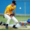 Globe/T. Rob Brown<br /> Diamond High School's (6) is unable to get ahold of the ball on a pickoff attempt as Hollister runner (12) makes it safe back to first base during Wednesday evening's sectional game at Carthage.<br /> Section: Sports Story: Anvil W.