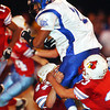Globe/T. Rob Brown<br /> Webb City defenders Jeff Stoner (44) and Zac Anderson (33) bring down Carthage ball carrier Caleb Sanders (2) Carthage during Wednesday night's game, Nov. 8, 2006, at Webb City.<br /> Section: Sports