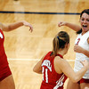 Globe/T. Rob Brown<br /> Webb City's (14) MacKenzie Rhea (left) celebrates with her teammates Jordan Bickett (11), Kayla Gaines (3), Kelsey Erwin (12) and others as Webb City wins the first game of the match against Nixa during the final of the District 12 Volleyball Tournament Wednesday night, Oct. 25, 2006, at Joplin High School.<br /> Section: Sports