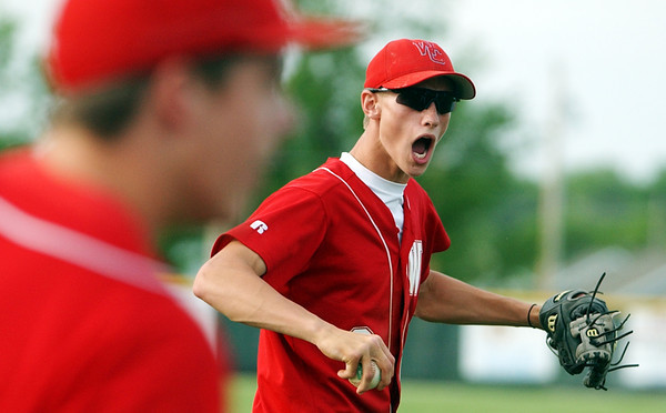 Globe/T. Rob Brown<br /> Webb City High School's Chance Sossamon (2) celebrates after getting a Seneca runner out at third base as part of a double play Thursday evening, May 18, 2006, during the district championship game at Barnes Field in Webb City.<br /> Section: Sports Story: Anvil Welch