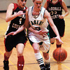 Globe/T. Rob Brown<br /> Pierce City's Jody Lathem (5) attempts to fend off defensive pressure from McDonald County's Layne Walters (4) as Walters' teammate Amanda Wilson (33) moves in to assist during Thursday night action, Dec. 28, 2006, during the Neosho Holiday Classic at Neosho Middle School.<br /> Section: Sports