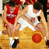 Globe/T. Rob Brown<br /> Carl Junction's Steven Tackett (33) and Webb City's Landon Zerkel (15) go after a loose ball following a rebound Monday night's game, Jan. 30, 2006, at Carl Junction High School.<br /> Section: Sports Story: Ryan