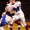 Globe/T. Rob Brown<br /> Joplin's (4) Cory Rector works to evade Rockhurst's (34) Steven Roepke during Friday night's game, Oct. 20, 2006, at Rockhurst High School.<br /> Section: Sports